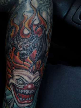 Evil-clown-winged-skull-tattoo-148764