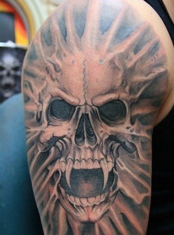 skull-vampire-tattoo-design-for-men-on-sleeve