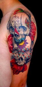 A-Day-of-the-Dead-tattoo-of-two-sugar-skulls-on-a-bed-of-roses