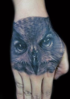 owl_tattoo_on_hand_by_hatefulss-d47zbyd