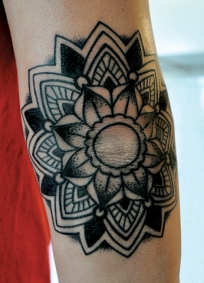 grey-ink-mandala-elbow-tattoo